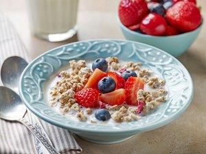 healthy breakfast, bowl of muesli with milk