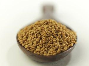 Indian spices-Fenugreek in wooden spoon.
