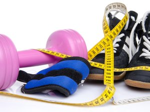 Pink dumbell, ankle weights and fitness shoes