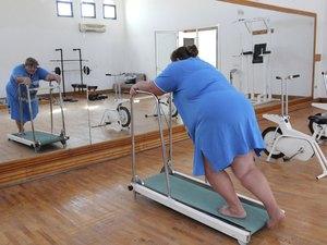 overweight woman running on trainer treadmill