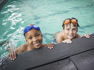 Little boys smiling in the pool