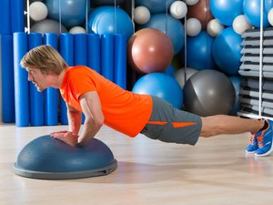 Bosu diamond push up blond man gym exercise