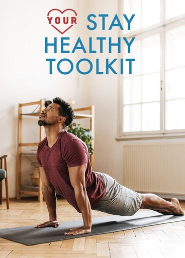man stretching at home to stay healthy