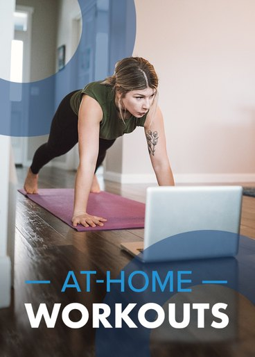 woman doing home workout on yoga mat with laptop