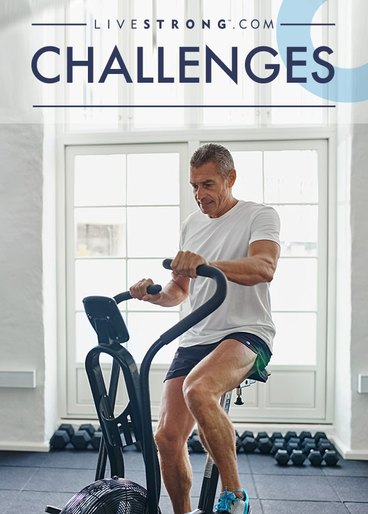 man on elliptical at home doing 30-day challenge