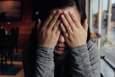woman crying indoors