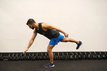 Man demonstrating how to do body-weight single-leg deadlifts