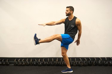 Man demonstrating how to do standing kickouts