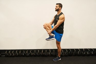 Man demonstrating how to do standing knee grab