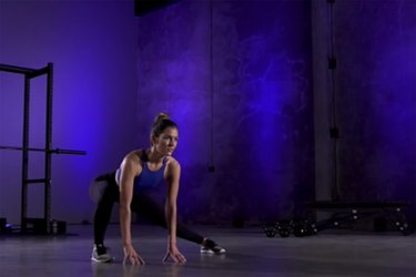 Woman demonstrating how to do the lateral squat stretch as part of a mobility workout