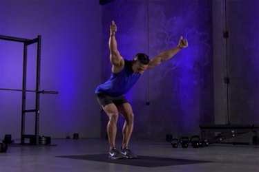 Woman demonstrating how to do the Y portion of Y, T, W mobility exercise