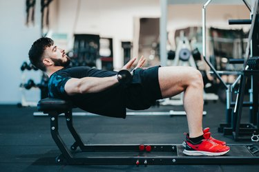 Man doing hip thrust exercise for glute strength