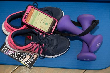 Brittany's shoes, weights and phone showing the MyPlate app