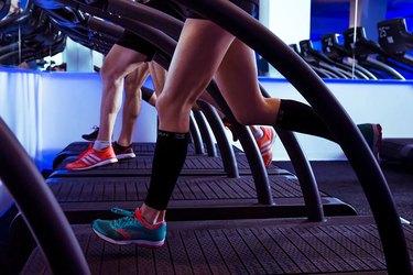 Runners doing treadmill workout class at Mile High Run Club