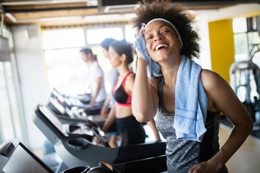 Woman running on the treadmill to get started at the gym