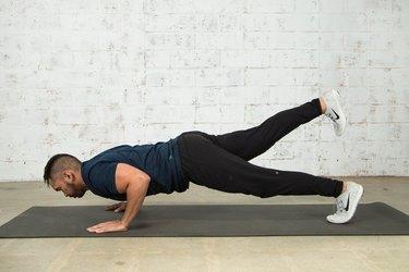 Mike Donavanik demonstrates a push-up with leg lift