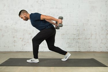 Mike Donavanik demonstrates a lunge with triceps extension