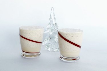 glasses of eggnog on white background