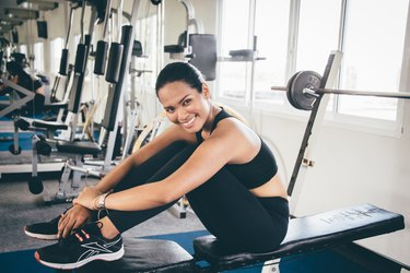 happy woman at the gym after a workout
