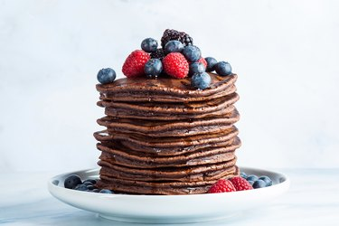 vegan chocolate pancakes with raspberries