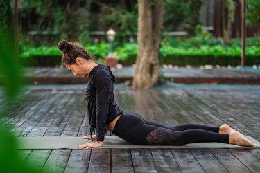 woman practicing pilates outdoors