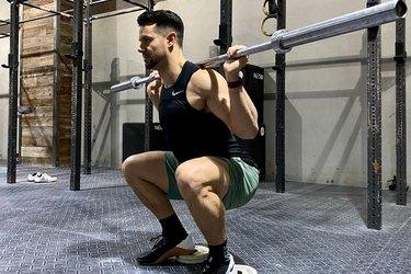 Mathew Forzaglia performing heel elevated squat.