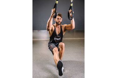 Man demonstrating how to do TRX Pistol Squats
