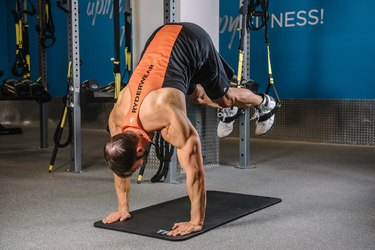 Man demonstrating how to do the TRX Pike