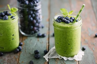 Green smoothie with blueberries on top for healthy smoothie recipe