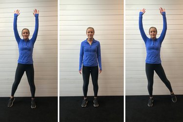 Woman demonstrating how to do a low-impact jumping jack