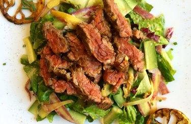 paleo salad with charred lemon and skirt steak