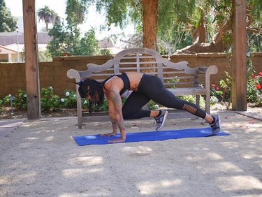 massy arias demonstrates Push-Up to Single-Leg Downward-Facing Dog With Knee Drive