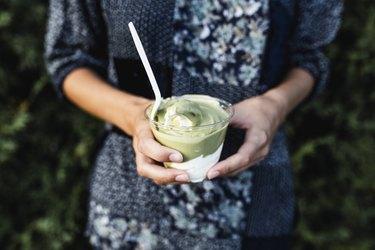Woman holding avocado ice cream