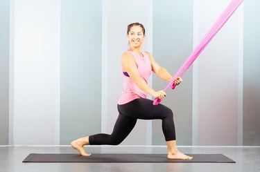 Proper form for resistance band lunge and twist