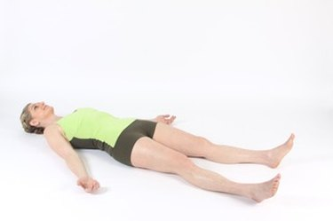 woman lying down on back demonstrating reconnect exercise for MELT method
