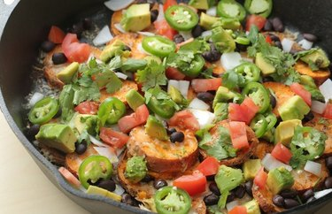 Sweet potato nachos with jalapenos in a pan