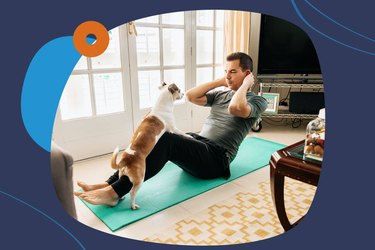 man doing sit-ups with his dog at home on exercise mat