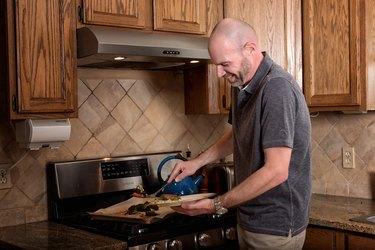 Scott cooks a meal.