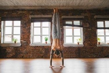 Man doing handstand yoga pose for balance