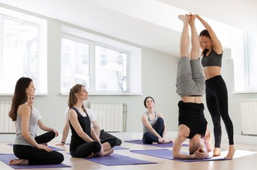 Man doing supported headstand yoga pose for balance