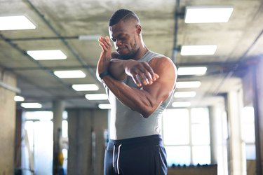 Man stretching with possible workout pain or injury
