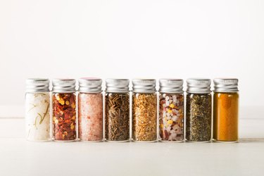 Row of spices in mini spice viles