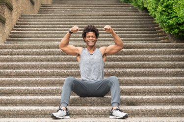 Errick flexes on the stairs