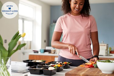 woman slicing vegetables for portion controlled meals