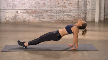 Jillian Michaels demonstrating how to do a reverse plank