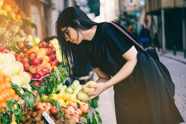 Woman at the farmer's market shopping for fruits and vegetables
