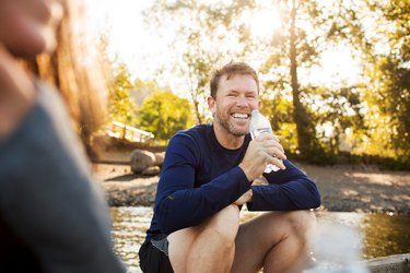 man smiling and drinking water perineal muscle exercises