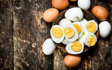 Hard-boiled eggs in a bowl on a wooden table