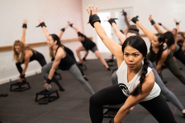 Group of people doing a Pure Barre workout class