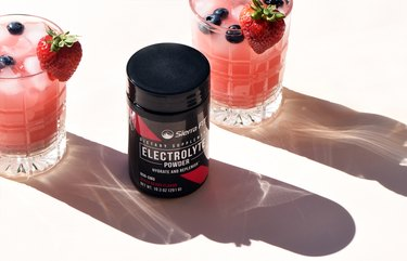 iHerb Sierra Fit BCAA and Electrolytes bottle sitting on a table with drinks